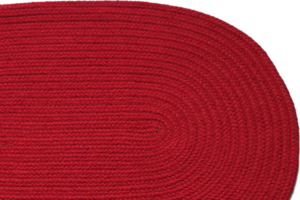 Charmant Solid Red. Braided Rug